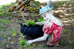 Creepy statue and pot Royalty Free Stock Images