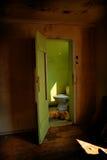 Creepy Toilet. Bathroom of an old abandoned house stock photo