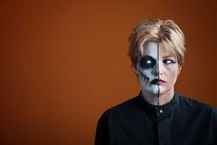 Creepy Woman. Woman wearing creepy makeup for Dia de los Muertos Royalty Free Stock Photos