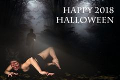 Creepy woman in the forest and the message `Happy 2018 Halloween` stock photo