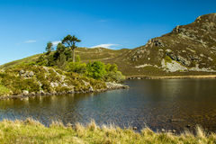 Cregennen Lakes A Welsh Landscape. Cregennan Lakes at Cadair Idris, is in the South end of Snowdonia. Looking across the lake to the island then on to the Stock Photos