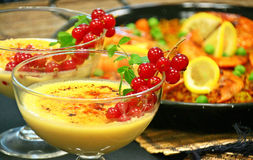 Crema catalana and paella Spanish lunch Royalty Free Stock Photography