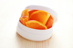 Crema de cara anaranjada Imagenes de archivo