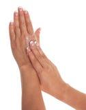 Crema de la mano Imagen de archivo libre de regalías