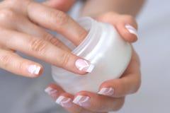 Crema de la mano Foto de archivo