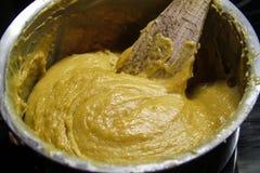 Crema de mezcla en el mezclador Foto de archivo