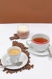 Crema del caffè, del tè e di choco fotografie stock