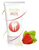Crema dental con la fresa. Fotografía de archivo