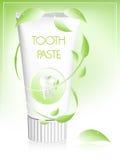Crema dental con las hojas. Imagen de archivo
