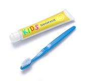 Crema dental y cepillo del niño Imágenes de archivo libres de regalías