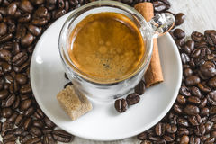 Crema on fresh espresso with sugar, cinnamon and coffee beans Royalty Free Stock Image