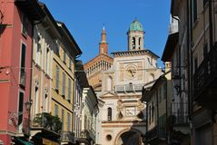 Crema town, Italy. Ancient houses and clock arch entrance to cathedral square, Crema town, Lombardy, Italy Stock Image