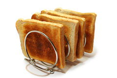 Cremagliera del pane tostato e pane tostato Immagine Stock
