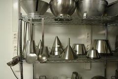 Cremalheira com o profissional que cozinha materiais Imagem de Stock Royalty Free