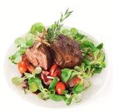 Cremalheira de cordeiro fritada rara no branco Imagem de Stock Royalty Free