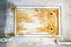 Cremallera abstracta en un sumirago oxidado cerrado de Italia del metal Imagenes de archivo