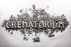 Crematório, palavra crematória escrita na cinza, nuvem de poeira imagens de stock