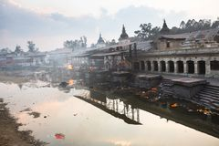 During the cremation ceremony along the holy Bagmati River in Bhasmeshvar Ghat at Pashupatinath temple Stock Photo