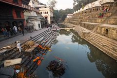 During the cremation ceremony along the holy Bagmati River in Bhasmeshvar Ghat at Pashupatinath temple Royalty Free Stock Photography