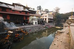 During the cremation ceremony along the holy Bagmati River in Bhasmeshvar Ghat at Pashupatinath temple Royalty Free Stock Image