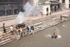 Cremation ceremony at Pashupatinath temple. Nepal. KATHMANDU, NEPAL - SEPTEMBER 21: Cremation ceremony along the holy Bagmati River in Bhasmeshvar Ghat at royalty free stock image
