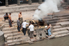 Cremation ceremony at Pashupatinath temple. Nepal, Kathmandu. KATHMANDU, NEPAL - SEPTEMBER 21: Cremation ceremony along the holy Bagmati River in Bhasmeshvar stock photo