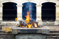 Cremation ghat and ceremony in Nepal. Cremation ceremony at Pashupatinath Temple in Kathmandu, Nepal stock photo