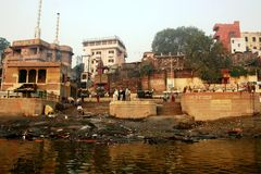 Cremation ghat in Varanasi. At the cremation ghats in the sacred town of Varanasi hindus burn the dead people to prevent them from reincarnation Stock Image