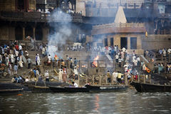 Cremation Ghats - Varanasi - India. The Manikarnika Hindu cremation ghats on the Holy River Ganges (Ganga) in the sacred town of Varanasi (Benares) in the Uttar Stock Photos
