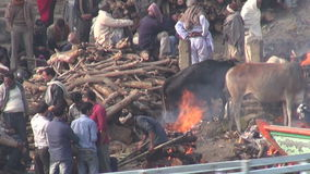Cremation place in varanasi on sacred Ganges river coast stock footage