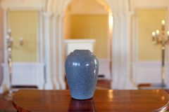 Cremation urn on table in church Stock Image
