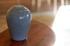 Cremation urn on table in church Royalty Free Stock Image