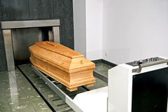 Crematory. A wooden coffin in a contemporary crematory. Funeral service royalty free stock images