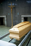 Crematory. Close up of the wooden coffin in a contemporary crematory Royalty Free Stock Images