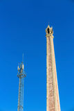 Crematory and cellular tower with blue sky Stock Images