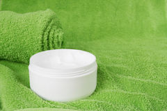 Creme. White creme and green towel Stock Photos