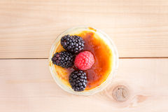 Creme Brule Custard Dessert with Fruit Garnish Royalty Free Stock Photography