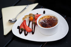Creme Brule with strawberries Royalty Free Stock Photography