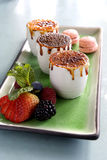 Creme Brulee. Photograph of a three creme brulee with fruit royalty free stock images