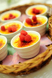 Creme Brulee. Topped with raspberries Stock Photos
