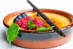 Creme brulee. With chocolate and raspberry Royalty Free Stock Image