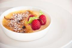 Creme Brulee. Close up shot of creme brulee dessert over white background Stock Photo