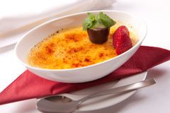 Creme Brulee. With strawberry in a cup Stock Photography