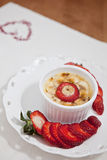 Creme brulee. With strawberries and banana Stock Image