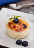 Creme Brulee With Blueberries. And mint garnish Royalty Free Stock Photos