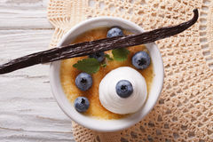 Creme brulee with blueberries closeup. horizontal top view Stock Images