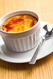 Creme brulee in ceramic bowl Stock Photos
