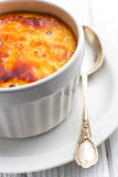 Creme brulee in ceramic bowl Stock Photography