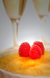 Creme Brulee and champagne with dramatic lighting Stock Photo