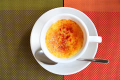 Creme Brulee in a coffee cup Stock Image